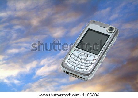 Mobile phone on sky background