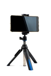 Mobile phone on the tripod isolated on white, vertical