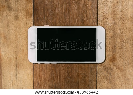 Mobile Phone on Wooden Background. Flat Lay Top View Photo
