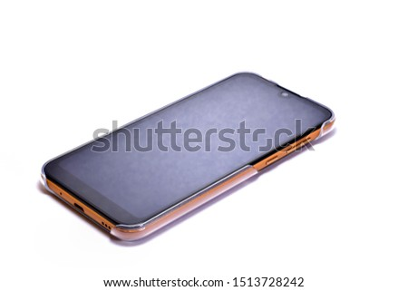 Mobile phone - Smart phone has a brown back, with a clear colored case   isolated on white background.