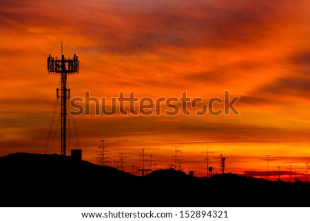 Mobile phone Telecommunication Radio antenna Tower. Cell phone tower with sunset sky, silhouette  #152894321