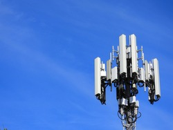 Mobile Phone Tower, Cell Tower - Right side of Image - Blue Sky Light Clouds
