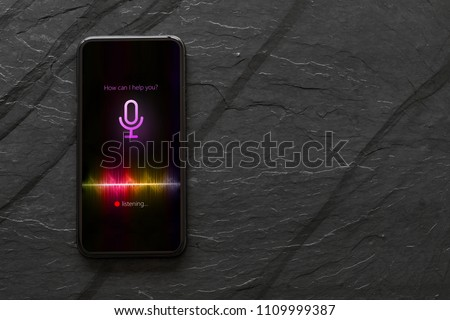 Mobile phone with activated voice assistant. #1109999387