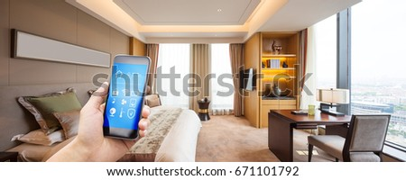 mobile phone with apps in modern luxury bedroom #671101792