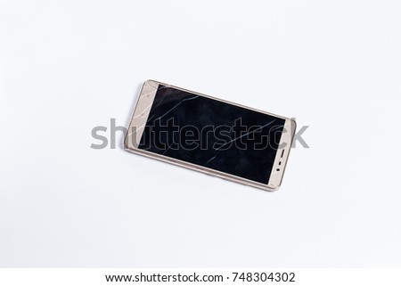 Mobile phone with broken screen on white background #748304302