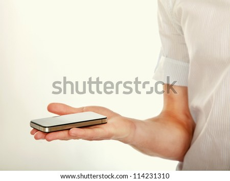 Mobile phone With hand, isolated on white background