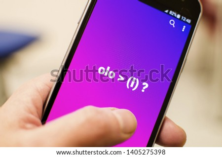 Mobile phone with indecent seducing proposal and simple male and female symbols. #1405275398