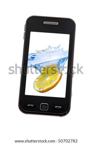 Mobile phone with lemon splash - stock photo