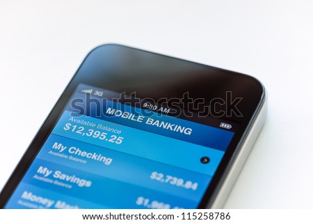 Mobile phone with mobile banking application on a screen. Closeup shot. - stock photo