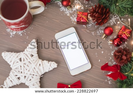 mobile phone written new years resolution on with xmas decoration