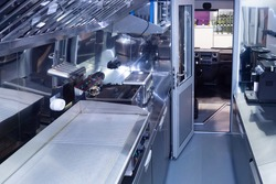 Mobile restaurant. Cafe on wheels. Kitchen in the van. Mobile cafe. The machine is equipped with kitchen equipment. Cooking in a special van.