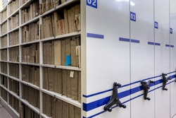 mobile shelves with documents. Archive or office, archive, file, registration