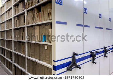 mobile shelves with documents. Archive or office, archive, file, registration Stockfoto ©