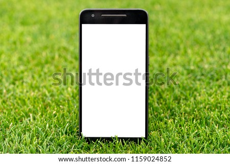 Mobile smart phone mockup with white screen on green grass background. Highly detailed illustration.