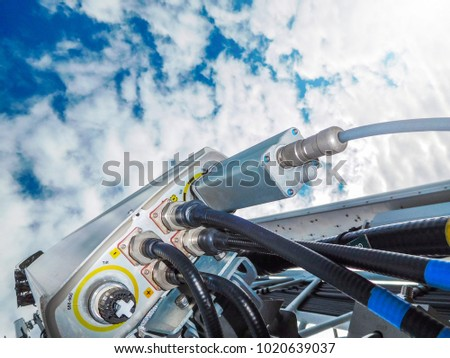 Mobile telephone network base station telecommunication tower with smart cellular antennas radiating and broadcasting strong digital signal waves from view from the top #1020639037