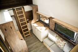 Mobile tiny house interior. Great for outdoor experiences and wildlife. Lots of space and pure adventure. No need for special authorizations, only a decent car to pull this tiny house and off you go.