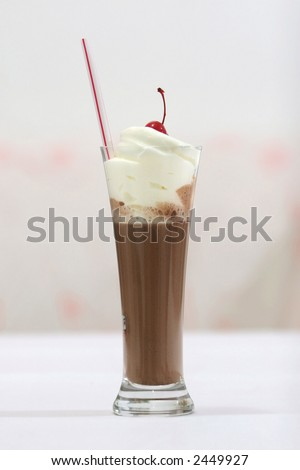 Mocha flavored hot chocolate drink with cream and cherry topping