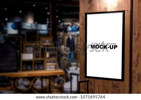 Mock up blank billboard for advertising with clipping path at front of fashion cloth shop in airport, empty space for promotion or information signboard on wooden panel