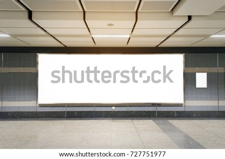 mock up blank billboard with copy space for advertising or media and content marketing at train station, marketing and advertising concept #727751977
