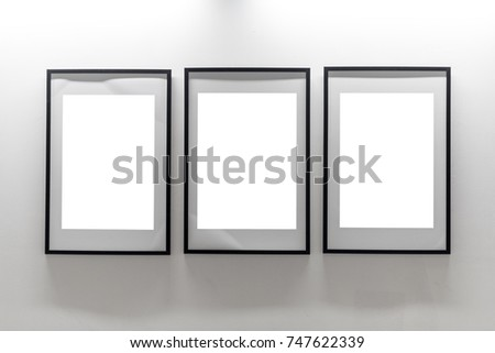 Mock up. Blank picture frames on white wall. Gallery wall with empty ...