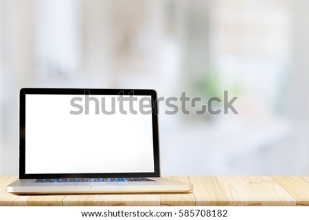 Mock up Blank screen Laptop wood table and blurred bath room background. #585708182