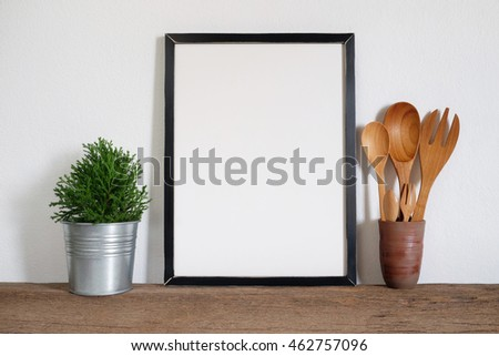mock up  frame with plant pot and utensils on wooden shelf