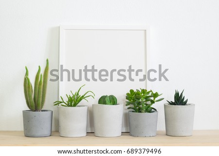 mock up frame  with succulent in concrete pot.hipster scandinavian home decor - Shutterstock ID 689379496