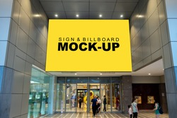 Mock up large billboard with clipping path on the wall over the entrance shopping mall, perspective yellow screen empty space to insert advertisement, blurred people walking in and out the door