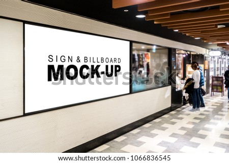 Mock up large signboard on the glass with clipping path, blank space with white screen for information or promotion advertising billboard, blurry people reading menu in front of the restaurant