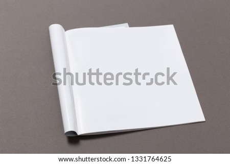 Mock-up magazine or catalog on gray background.Blank page or notepad for mockups or simulations.  #1331764625