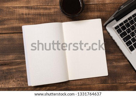Mock-up magazine or catalog on wooden table. Blank page or notepad on wood background. Blank page or notepad for mockups or simulations. #1331764637