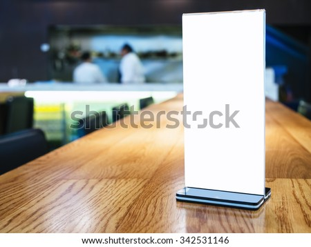 Mock up Menu frame on Table in Bar restaurant cafe with Bartender
