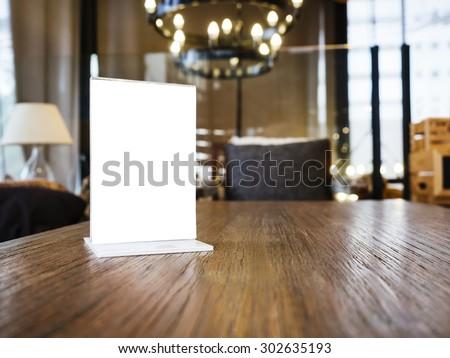 Mock up Menu frame on Table with Restaurant Cafe Shop Interior Background