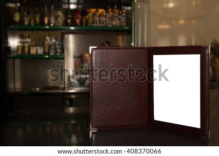 Mock up Menu frame on the blurred background of the bar. Open Menu book bound in leather stands on the bar #408370066