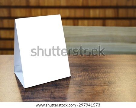 Mock up Menu Frame template on table in Restaurant cafe