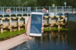 Mock-up of a smartphone against the background of crossing the dam