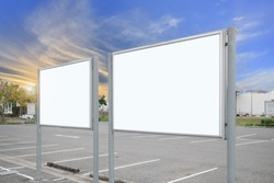 mock up of blank showcase billboard or advertising light box for your text message or media content with car in the parking lot in row, commercial, marketing and advertising concept.