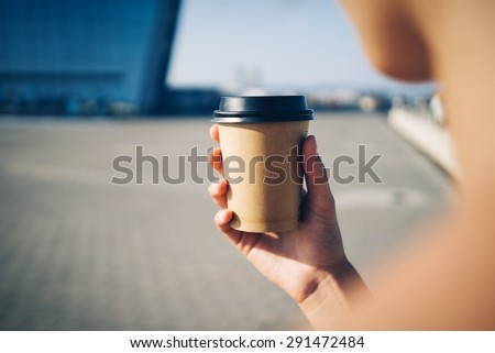 mock up of cup a coffee in the city
