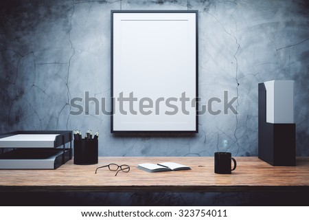 mock up of empty picture frame on the desk