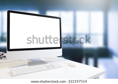 Mock up of generic design computer screen. workspace in business office room in blue tone.copy space