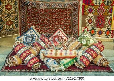 Mock up of Many precious ancient colored wool Azeri carpets and ancient pillows made by hand in the Middle East.