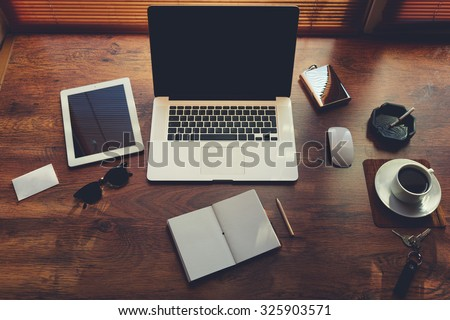 Mock up of rich business person workplace with luxury accessories and distance work tools, laptop computer and digital tablet with blank copy space for text message or information content