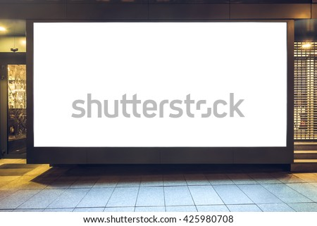 Mock up of store blank street showcase window in a city at night. Front view