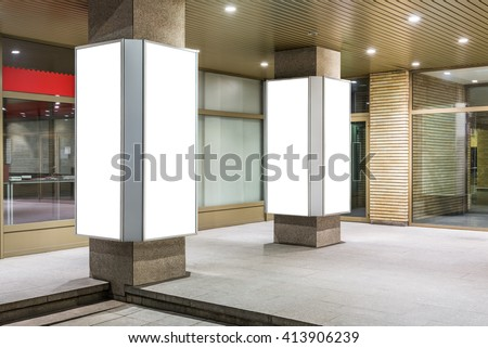 Mock up of two vertical lightboxes in city space at night #413906239