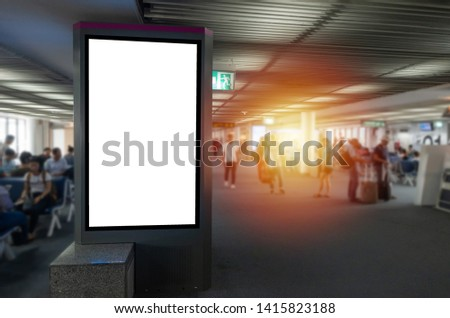 mock up of vertical blank advertising billboard or light box showcase in waiting zone at airport, copy space for your text message or media content, advertisement, commercial and marketing concept