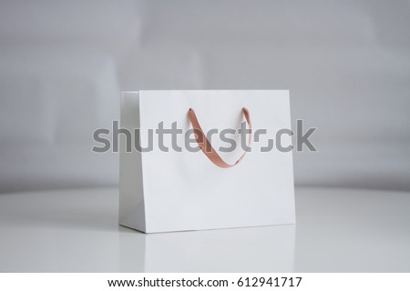 Mock-up of white shopping bag on neutral background