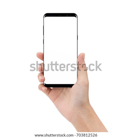 mock up phone in holding hand isolated on white background clipping path inside #703812526