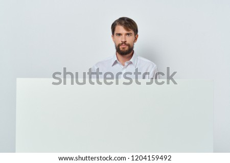 22ddf81c617 Free photos Young fashionable man with a blank sign.
