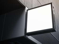 Mock up Signboard black frame square shape Front Shop Sign Modern building