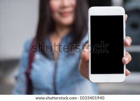 Mock up, smart woman showing blank screen mobile smart phone, for product display, mobile application or webpage advertising #1033401940